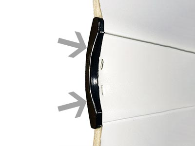 ou se trouve le bouchon de lame d'un tablier de volet roulant